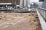 폭우가 쏟아진 7일 오후 광주 서구 양동복개상가 인근 양동교를 지나는 광주천이 불어나 있다. 연합뉴스