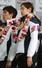25일 오후 인천국제공항에서 열린 제22회 소치동계올림픽 대한민국 선수단 해단식에서 이승훈(왼쪽), 김연아 선수가 국민의례를 하고 있다. 2014.2.25. 연합뉴스