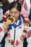 2014 소치 동계올림픽 대표팀 김연아 선수가 25일 오후 인천국제공항 입국장을 통해 초콜릿으로 만든 \%!^a국민행복 메달\%!^a을 입에 무는 포즈를 취하고 있다. 2014.2.25/뉴스1