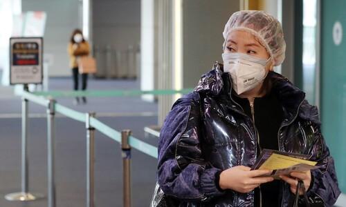 [포토] 물안경에 샤워캡에…신종 코로나 최전선 인천공항