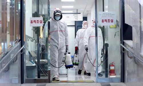 '코로나 최전선' 의료진 20여명 감염…병원 폐쇄 '의료공백' 우려